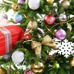 Gift box on Christmas tree closeup — Stock Photo #54851263