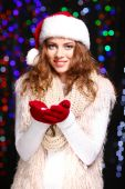 Portrait of woman in scarf and gloves on bright lights background — Stok fotoğraf