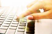 Female hand on laptop, close up — Stock Photo
