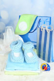 Baby clothes and gift bag — Stock Photo