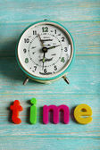 Time word formed with colorful letters on wooden background — Stock Photo