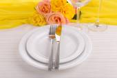 Table setting with yellow rose on plate — Stock Photo