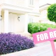 Real estate sign in front of new house for rent — Stock Photo #55017307
