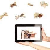 Information transfer. Books flying in tablet — Stock Photo