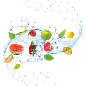 Fresh fruit, vegetables and green leaves with water splash, isolated on white — Stock Photo