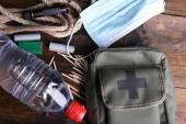 Emergency preparation equipment on wooden background — Stock Photo