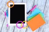 Tablet, bracelet, notebook — Stock Photo