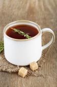 Cup of tasty herbal tea — Stock Photo