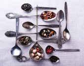 Tea in metal spoons — Stock Photo