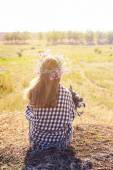 Woman waiting for summer sun on meadow — Stock Photo