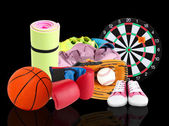 Sporting goods on black background — Stock Photo