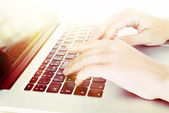 Female hands on laptop, close-up — Stock Photo