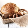 Fresh bread on wooden table, close up — Stock Photo #55322753
