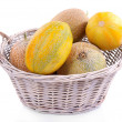Melons in basket isolated on white — Stock Photo #55323217
