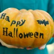 Girl holding Halloween pumpkin — Stock Photo #55329157