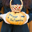 Girl holding Halloween pumpkin — Stock Photo #55329163