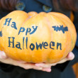 Girl holding Halloween pumpkin — Stock Photo #55329167