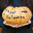 Girl holding Halloween pumpkin — Stock Photo #55329169