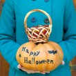 Girl holding Halloween pumpkin — Stock Photo #55329175