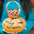 Girl holding Halloween pumpkin — Stock Photo #55329179