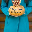 Girl holding Halloween pumpkin — Stock Photo #55329185