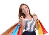 美丽的年轻女子,与孤立在白色的购物袋 — 图库照片