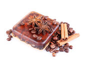 Organic soap with coffee beans and spices, isolated on white — Stock Photo