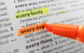 Orange marker highlighting word in dictionary — Stock Photo