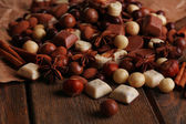 Different kinds of chocolates on wooden table close-up — Stock Photo