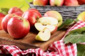 Sweet apples  on table on bright background — Stock Photo
