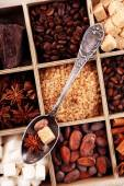 Wooden box with set of coffee and cocoa beans, sugar cubes, dark chocolate, cinnamon and anise, close-up — Stok fotoğraf