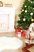 Beautiful Christmas interior with fireplace and fir tree — Photo