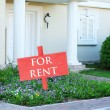 Real estate sign in front of new house for rent — Stock Photo #55568069