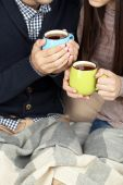 Loving couple with hot drinks — Stock Photo