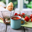 Homemade tomato juice in color mug, bread sticks, spices and fresh tomatoes on wooden table, on bright — Stock Photo #55635715