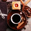 Cup with coffee drink, soap with coffee beans and spices on wooden background. Coffee spa concept — Stock Photo #55639057