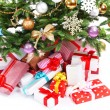 Presents under Christmas tree isolated on white — Stock Photo #55639901