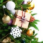 Gift box on Christmas tree closeup — Stock Photo #55639963