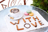 Cup of coffee with cute drawing on table, close up — Stock Photo