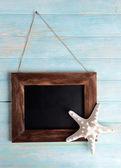 Vintage frame on wooden background — Stock Photo