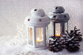 White and metal flash lights and Christmas decoration on light background — Stock Photo