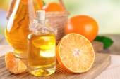 Tangerine oil on table close-up — Stock Photo