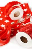 Ribbons with scissors and fabrics close up — Stock Photo