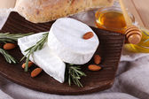 Camembert cheese on plate — Stock Photo