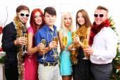 Young people celebrating Christmas  — Stock Photo