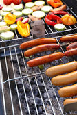 Sausages on barbecue grill — Stock Photo