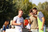 Young friends having barbecue party, outdoors — Stock Photo