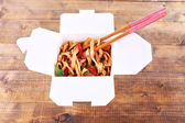 Chinese noodles in takeaway box — Stock Photo