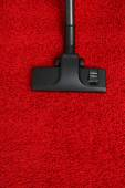 Vacuum cleaner to tidy up carpet — Stock Photo