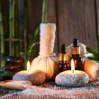 Spa set on bamboo mat on wooden wall background — Stock Photo #55640347